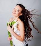Muchacha con las flores del tulipán Imagen de archivo