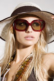 Muchacha con las gafas de sol imagen de archivo