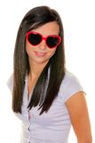 Muchacha con las gafas de sol del corazón Imágenes de archivo libres de regalías