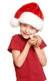 Muchacha con las galletas para santa, concepto de la Navidad de las vacaciones de invierno Imagen de archivo