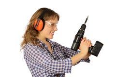 Muchacha con las herramientas para la reparación. Foto de archivo
