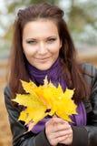 Muchacha con las hojas Fotografía de archivo