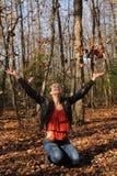 Muchacha con las hojas Fotografía de archivo libre de regalías