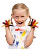Muchacha con las manos pintadas Imagen de archivo