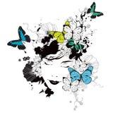Muchacha con las mariposas y las flores Foto de archivo libre de regalías