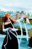 Muchacha con las plumas Foto de archivo libre de regalías