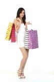 Muchacha con las porciones de bolsos de compras Imágenes de archivo libres de regalías