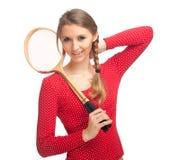 Muchacha con las raquetas de bádminton Fotos de archivo libres de regalías