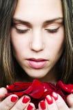 Muchacha con las rosas Imagen de archivo libre de regalías