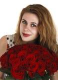 Muchacha con las rosas rojas foto de archivo libre de regalías