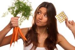 Muchacha con las tablillas y las zanahorias Imagen de archivo