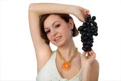 Muchacha con las uvas Foto de archivo libre de regalías