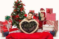 Muchacha con los accesorios de la Navidad Fotografía de archivo libre de regalías