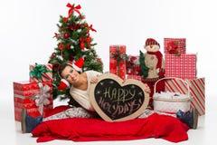 Muchacha con los accesorios de la Navidad Foto de archivo libre de regalías