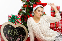 Muchacha con los accesorios de la Navidad Imágenes de archivo libres de regalías
