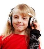 Muchacha con los auriculares. Imagen de archivo