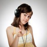 Muchacha con los auriculares Fotografía de archivo