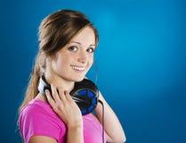 Muchacha con los auriculares Imagenes de archivo