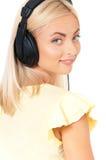 Muchacha con los auriculares Imágenes de archivo libres de regalías
