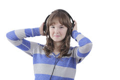 Muchacha con los auriculares en el disco Imagen de archivo libre de regalías