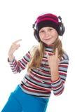 Muchacha con los auriculares que escucha la música Imagen de archivo libre de regalías