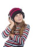 Muchacha con los auriculares que escucha la música Fotografía de archivo