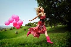 Muchacha con los baloons Imagenes de archivo