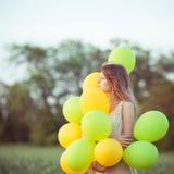 Muchacha con los baloons Imágenes de archivo libres de regalías