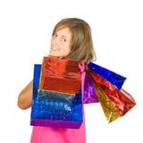 Muchacha con los bolsos de compras Imagen de archivo