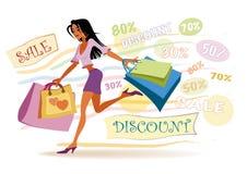 Muchacha con los bolsos de compras Imagen de archivo libre de regalías
