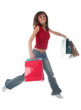 Muchacha con los bolsos de compras Fotografía de archivo libre de regalías
