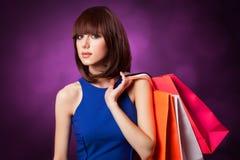 Muchacha con los bolsos de compras - sally fotografía de archivo libre de regalías