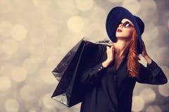 Muchacha con los bolsos de compras - sally imagen de archivo libre de regalías