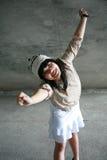 Muchacha con los brazos levantados Fotos de archivo libres de regalías