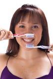Muchacha con los cepillos de dientes 2 Imagen de archivo libre de regalías