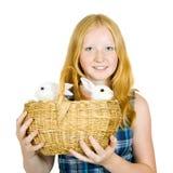 Muchacha con los conejos del animal doméstico Foto de archivo libre de regalías