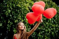Muchacha con los corazones Imágenes de archivo libres de regalías