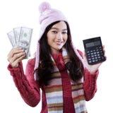Muchacha con los dólares de la calculadora y del dinero Fotografía de archivo libre de regalías