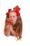 Muchacha con los filetes rojos Imagen de archivo libre de regalías