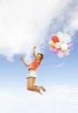 Muchacha con los globos coloridos Fotos de archivo libres de regalías
