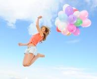 Muchacha con los globos coloridos Imágenes de archivo libres de regalías