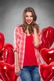 Muchacha con los globos rojos Imagenes de archivo
