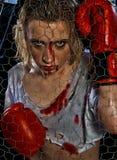 Muchacha con los guantes de boxeo Foto de archivo libre de regalías