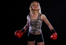 Muchacha con los guantes de boxeo Imagen de archivo