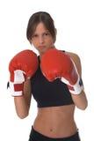 Muchacha con los guantes de boxeo rojos Fotografía de archivo