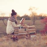 Muchacha con los libros Foto de archivo libre de regalías