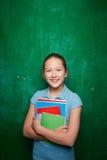 Muchacha con los libros de texto Imagen de archivo