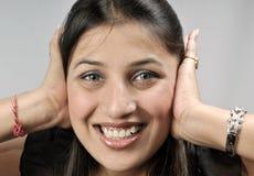 Muchacha con los oídos cubiertos Fotos de archivo