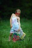 Muchacha con los panieres en parque del verano Imagen de archivo