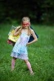 Muchacha con los panieres en parque del verano Imágenes de archivo libres de regalías